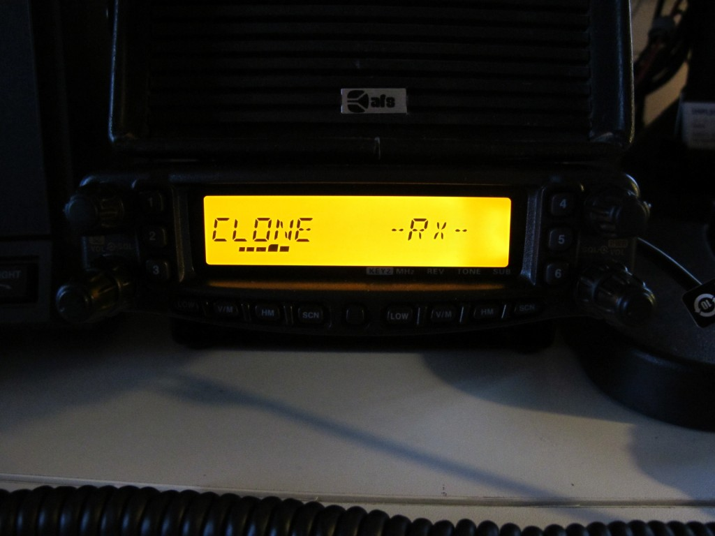 Radio in RX mode with bar showing uploading to radio progress